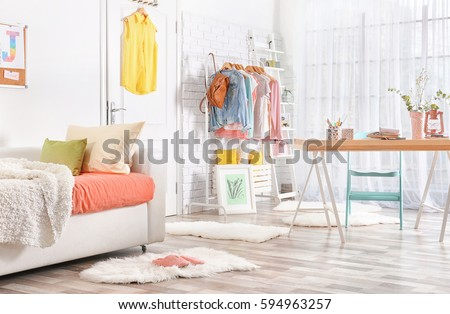 Interior Of Teenage Girlu0027s Room With Sofa