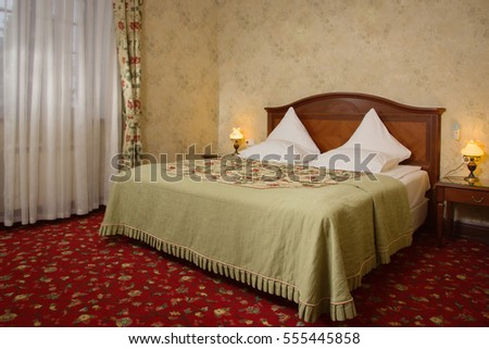 Interior of the beautiful bedroom with a vintage bed