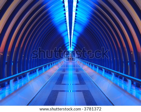 Interior of the bridge (blue light inside, red sunset outside) - stock photo