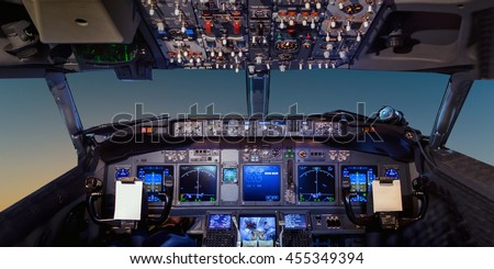 Interior of the cockpit Airplane flying above tropical sunset