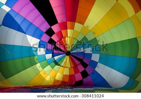 Interior of the envelope of a hot-air balloon during the cold inflation stage of prepping for launch. - stock photo