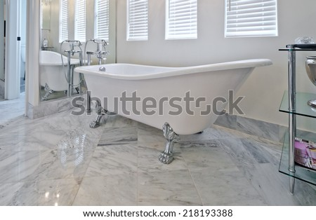 Interior of the luxury modern bathroom with marble floor. - stock photo
