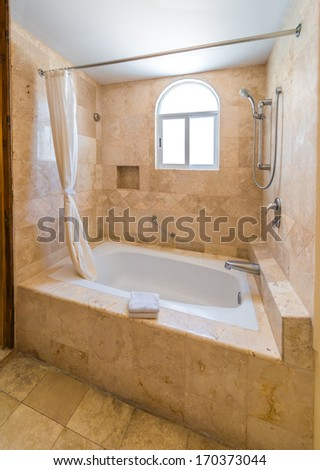 Interior of the luxury modern hotel, house bathroom with marble floor. - stock photo