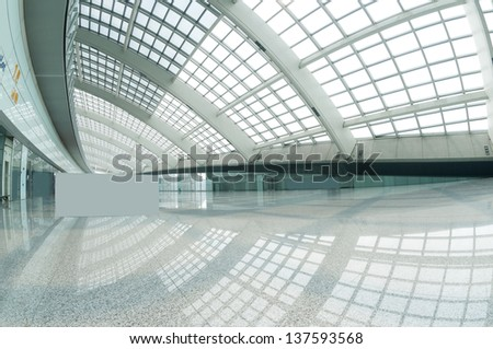 interior of the modern mall of beijin airport subway station - stock photo
