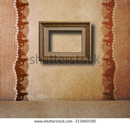 Interior of the old room with the remains of former beauty, with gilded wooden frame - stock photo