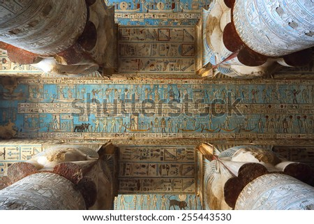 Interior of the painted and carved hypostyle hall at Dendera Temple. Ancient Egyptian temple near Qena. - stock photo