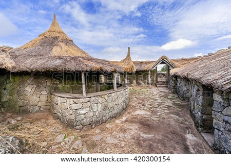 Interior of the reconstructed family nucleus building in Citania de Sanfins. A Castro Village (fortified Celtic-Iberian pre-historic settlement) in Pacos de Ferreira, Portugal. - stock photo