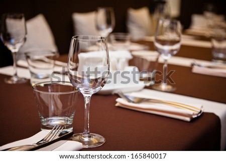 interior of the restaurant, a table with instruments, comfortable armchairs