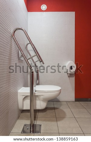 Interior of toilet with an appliance for disabled