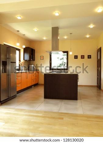 Interior of well-lit modern kitchen,vertical - stock photo