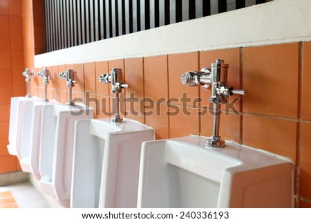 interior of white urinals in men bathroom toilet