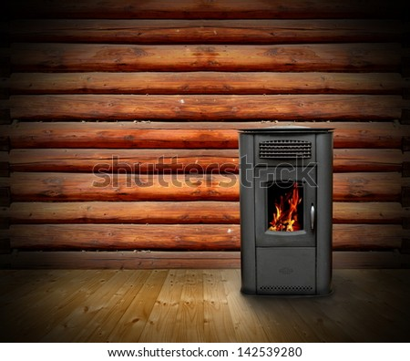 interior of wooden cabin with vintage stove and burning fire- empty backdrop for your design - stock photo