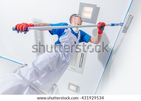 Interior Painting Business. Professional Room Painter at Work. Walls Painting. - stock photo