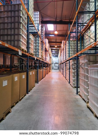 interior perspective of a three storeys high hall, in an industrial warehouse, with products stored on shelves - stock photo