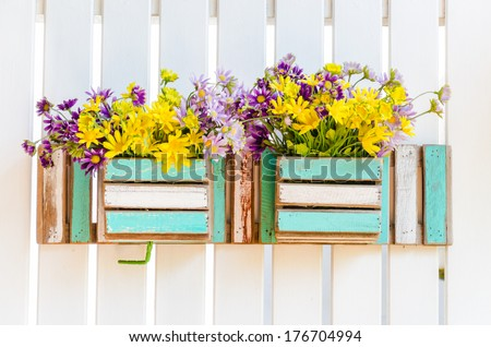 Interior plastic flower in vase - stock photo