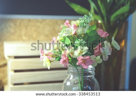 Interior plastic flower in vase