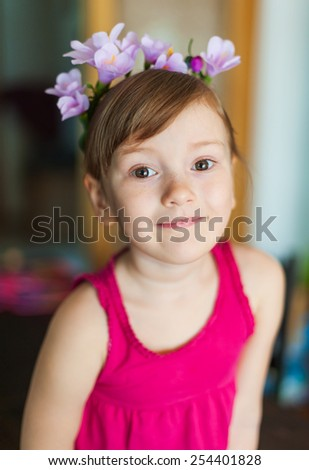 Interior portrait of a cute little girl playing at home - stock photo