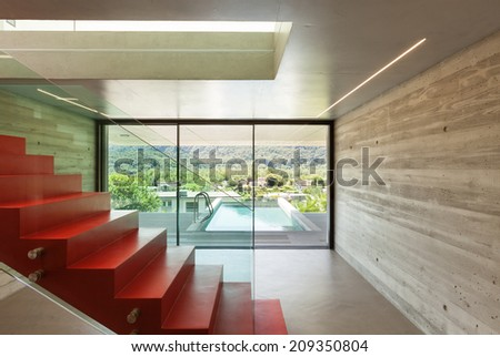 Interior, red staircase in modern villa