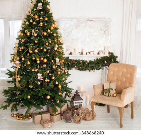 Interior room decorated in Christmas style. No people. An empty chair. Neutral colors. Home comfort of modern home.