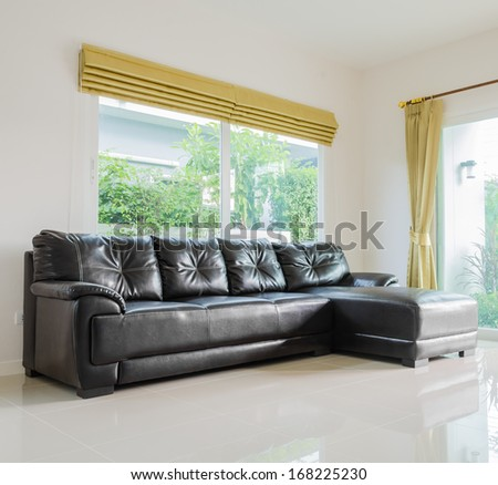 Interior room with black sofa in living room area - stock photo