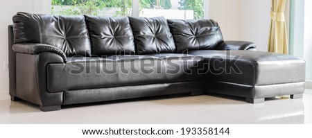 Interior room with black sofa in living room area