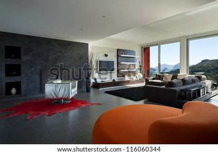 Interior, room with comfortable armchair orange - stock photo