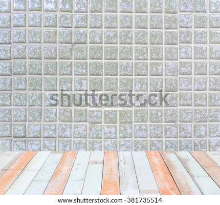 Interior room with old square tiles ceramic deep green color with grey filling wall and wooden painted floor - stock photo