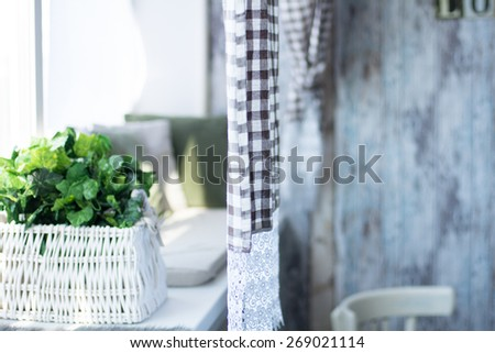 Interior rustic rooms with curtains and flowers on the windowsill. In a retro style - stock photo
