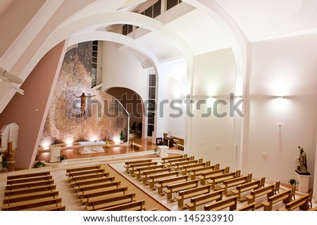 Interior Shot Of An Large Modern Catholic Church With High Ceiling