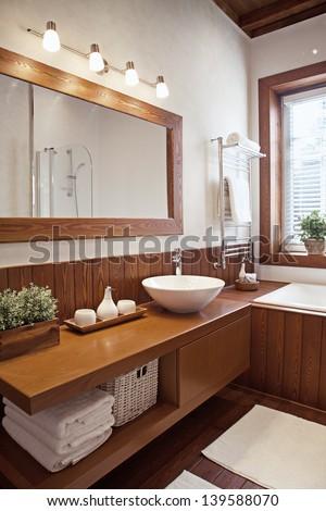 Interior shot of contemporary bathroom in sunlight  - stock photo