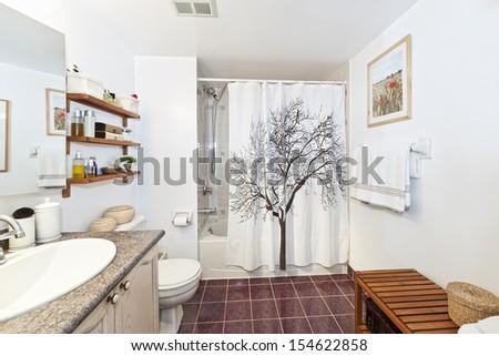Interior three piece bathroom - artwork on wall from photographer portfolio - stock photo