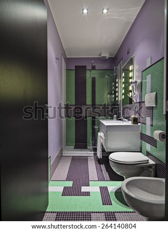 interior view o a modern bathroom with colored mosaic tiles - stock photo