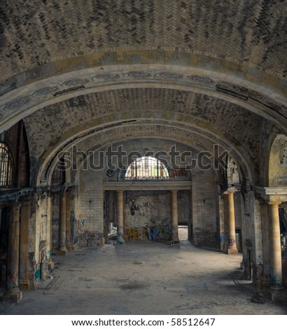 Interior view of a derelict abandoned train station lobby.