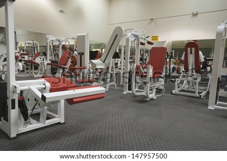 Interior view of a gym with equipment - stock photo