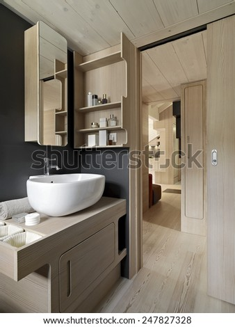 interior view of a modern bathroom with wood paneling - stock photo