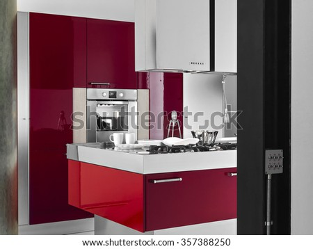 interior view of a modern kitchen on foreground of red kitchen island  - stock photo