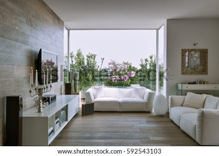 Interior View Of A Modern Living Room Overlooking On The Terrace With White Fabric Couch And