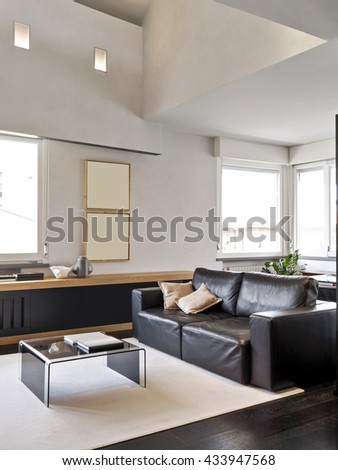 interior view of a modern living room with carpet and black leather sofa - stock photo