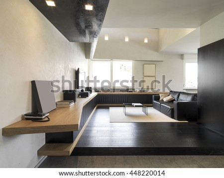 interior view of a modern living room with carpet and black leather sofa