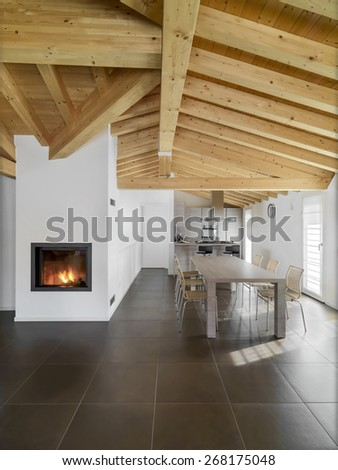 Interior View Of A Modern Living Room With Dining Table Fireplace And Wood Ceiling Overlooking