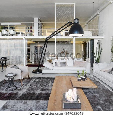 interior view of a modern living room with loft - stock photo