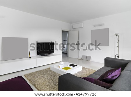 Interior View Of A Modern Living Room With Television Overlooking On The Bedroom