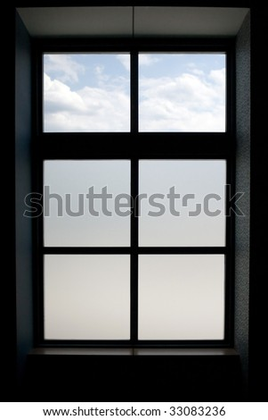 Interior view of a modern window that has frosted glass on the lower panes. - stock photo