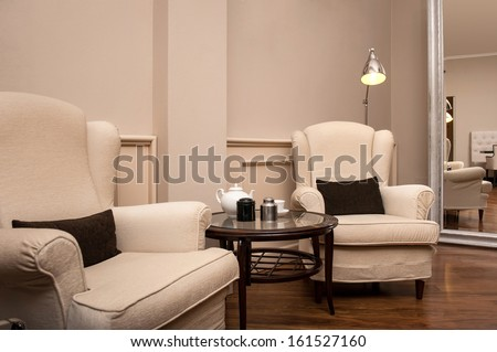 Interior view of luxury hotel lobby with armchairs. - stock photo