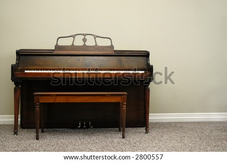 Interior view of piano and bench in a home - stock photo