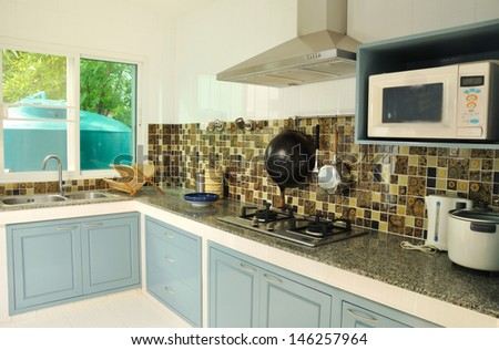 interior, view of the blue kitchen in small house - stock photo
