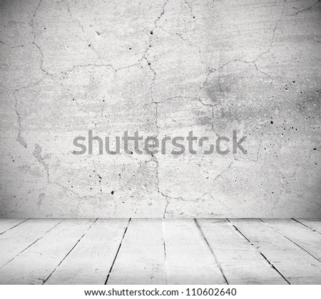 Interior, vintage background of stone wall and wooden floor - stock photo