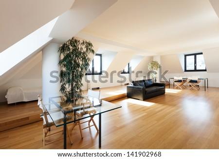 Interior, wide loft, hardwood floor, view living room - stock photo