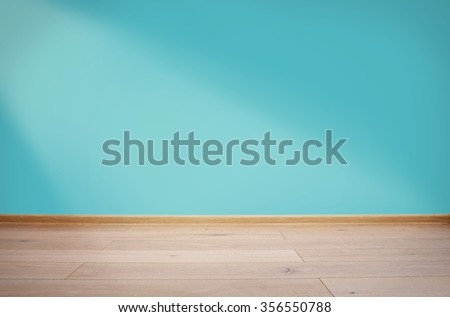 Interior with blue wall and wooden floor - stock photo