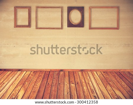 interior with fourth vintage frames on wall, retro filtered, instagram style - stock photo